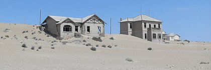 Homes from colonial times in the diamond city of Kolmanskop are seized by the dunes of the Namib Desert. 